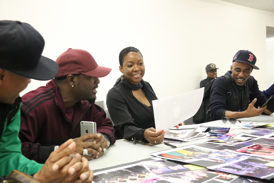 Members of New Edition working with the costume designer. (Source: Rolling Out)