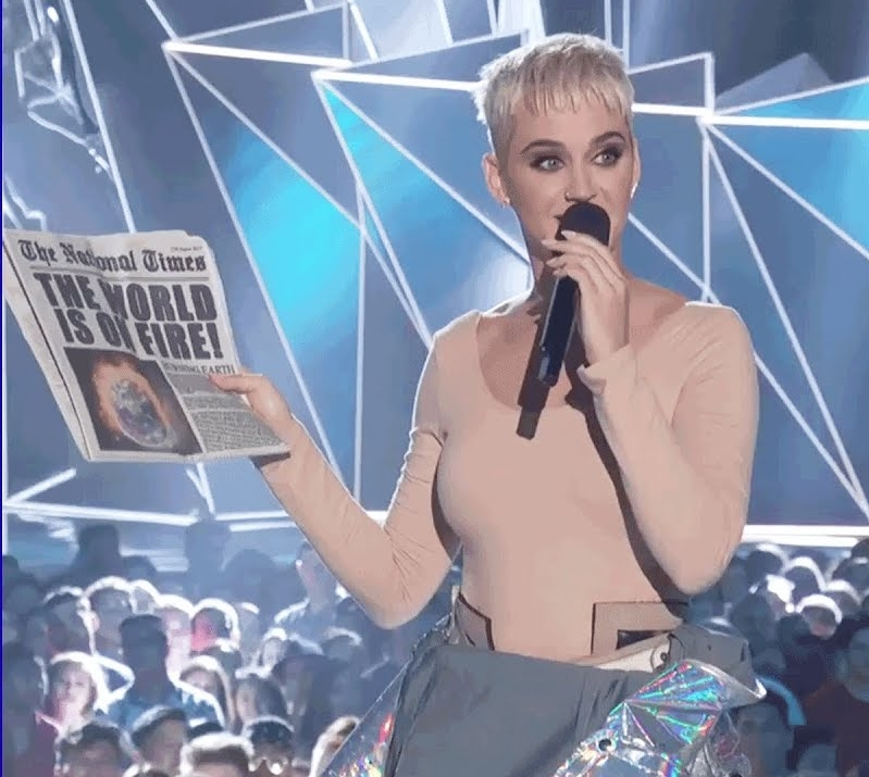 Katy Perry made numerous jokes about the state of the world and the political climate while hosting the VMAs. (Source: Google)
