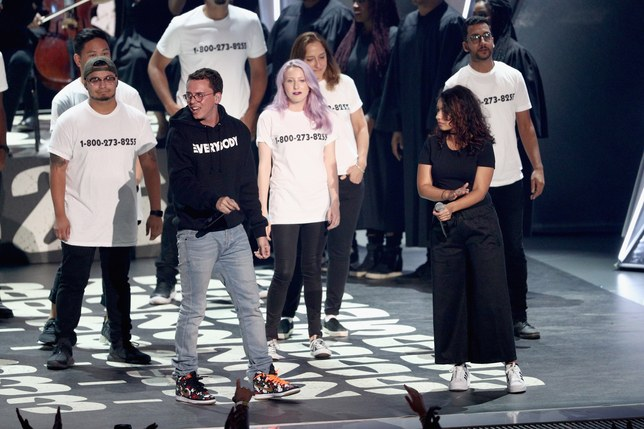 ;Logic, Alessia Cara, and Khalid (not pictured here) stand with suicide attempt survivors during their emotional performance.