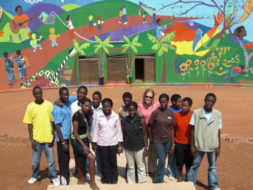 Tanya and Students in Front of Community Center