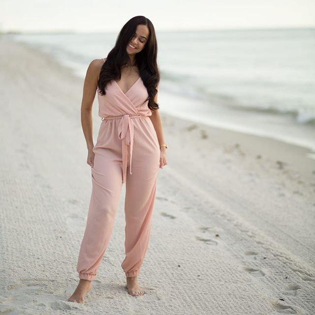 """I can feel the excitement for Fall even here at the beach 😍Lots of new things happening this season! Some unexpected uncertainties too. Who's with me?! ••• """"You will keep in perfect peace all those who trust in you, all whose thoughts are fixed on you"""" Isaiah 26:3! ••• Wearing the @joeyleecollection blush jumpsuit 💕 can't wait to pair this with a leather or jean jacket + some heels for the cooler weather! ••• 📷 @piperarielle"""