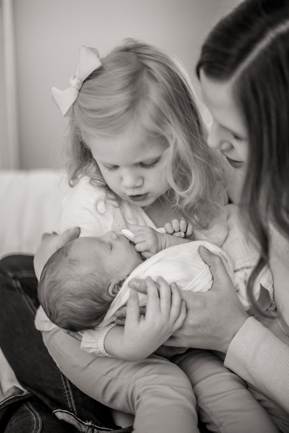 Big-Sister-Shushing-Baby-Brother-during-Newborn-Lifestyle-Session.jpg