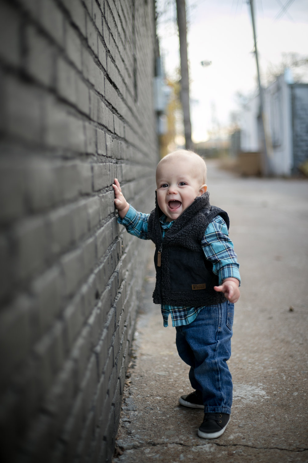 One-Year-Old-Baby-Standing-in-Tulsa's-Pearl-District-during-Family-Lifestyle-Session.jpg