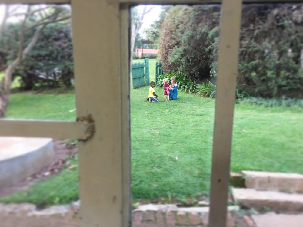 "The view from my kitchen window. The other missionaries' kiddos are so sweet and always willing to help ""watch"" Silas."