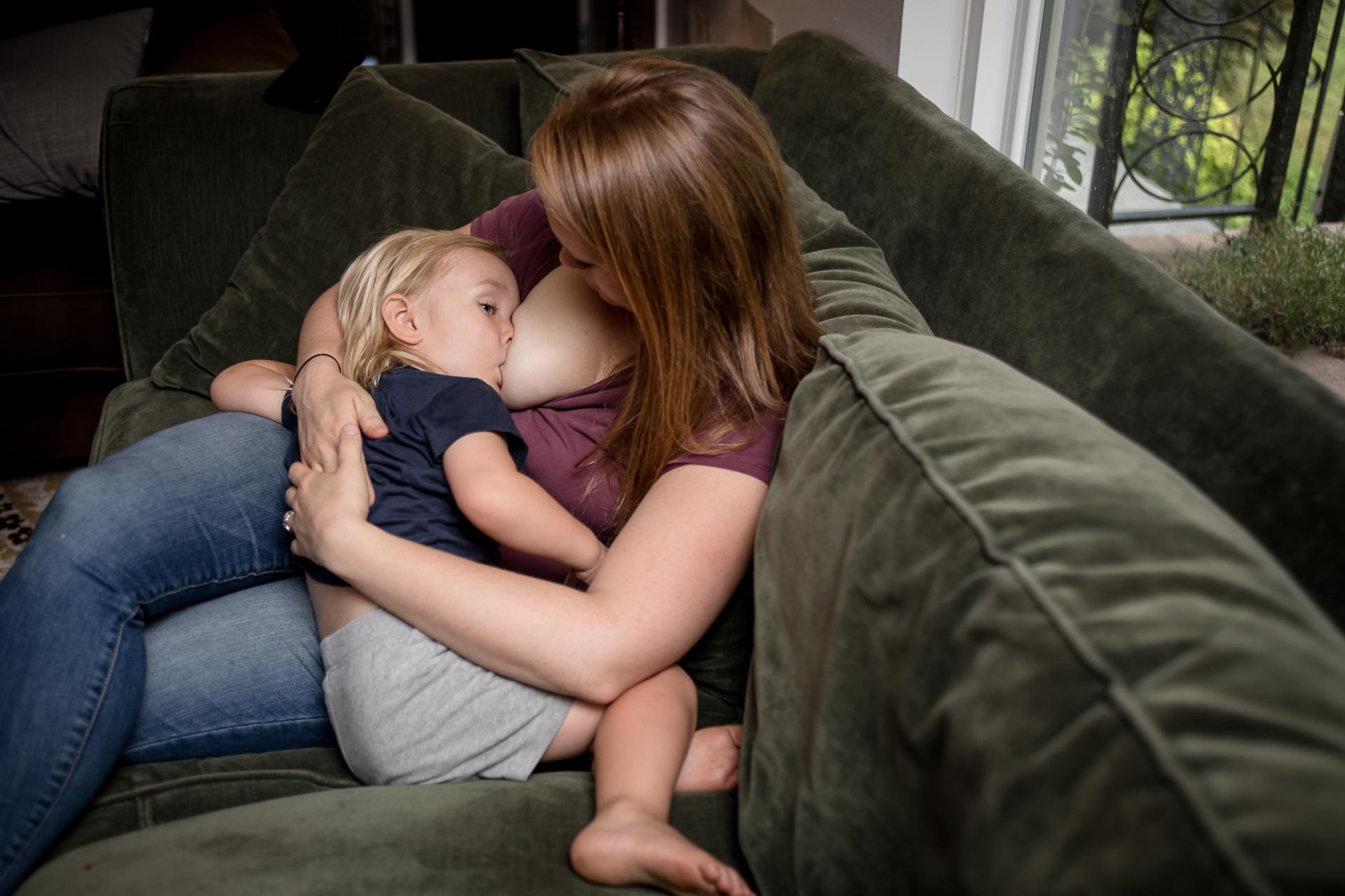 Young teen girl breastfeeding