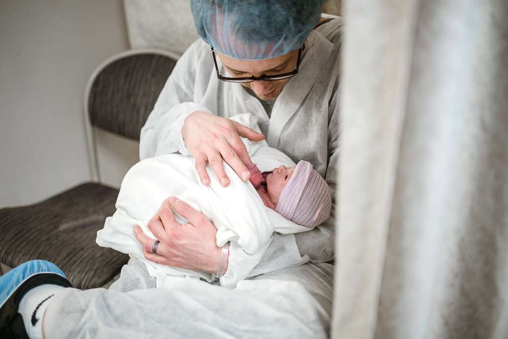 Dad-holding-newborn-girl-after-cesarean-Tulsa-birth-photography-by-Micah-Lynn-Birth-Stories.jpg