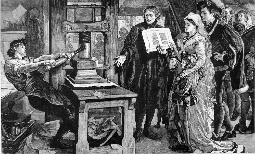The_Caxton_Celebration_-_William_Caxton_showing_specimens_of_his_printing_to_King_Edward_IV_and_his_Queen.jpg