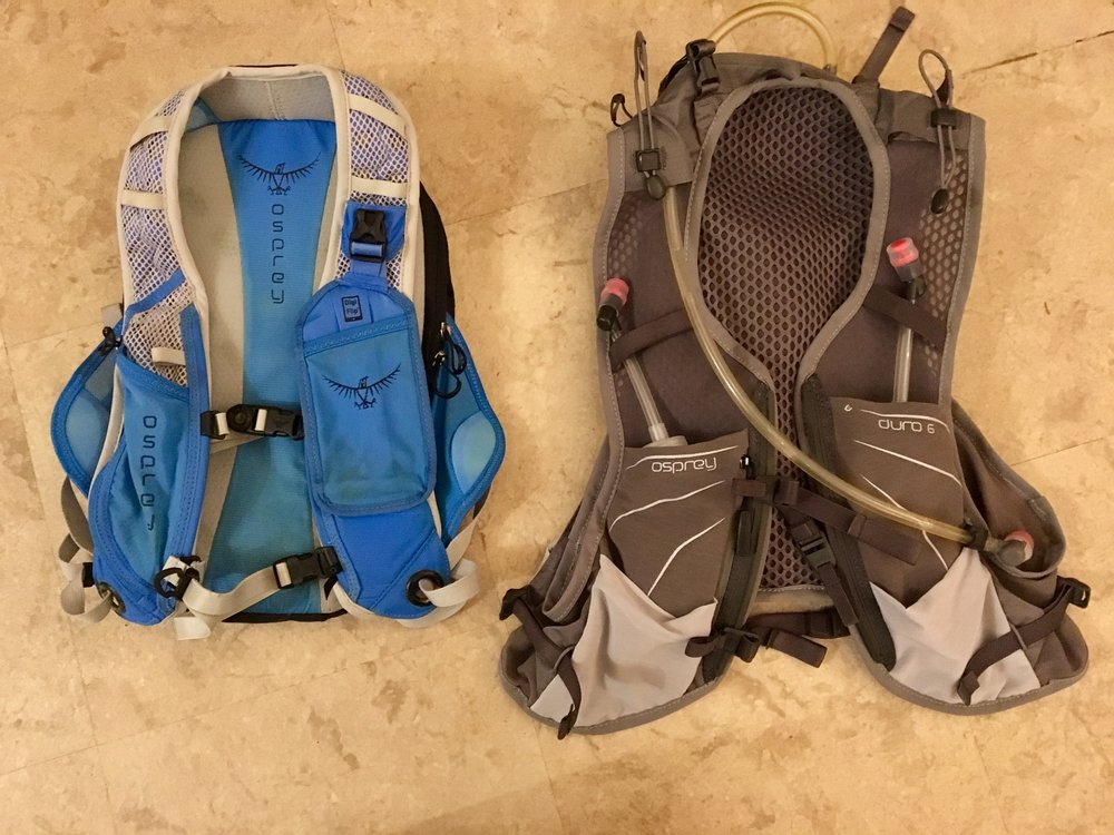 Upgrade. Osprey dipped their toe in the water of ultra-running packs with the excellent Rev 6 (left); so when I got my hot little hands on the race-vest style Duro 6 (right) I was pretty excited and the difference is massive. The balance changes, it's snugger - reminds me of one of their old slogans: 'clings to your back like a frightened monkey'! The accessibility of the soft bottles on the chest is fantastic and allowed me to carry 3.5L fluid. The chest harness is improved and the functionality has been thought through so well - the usability is fantastic. Get one.