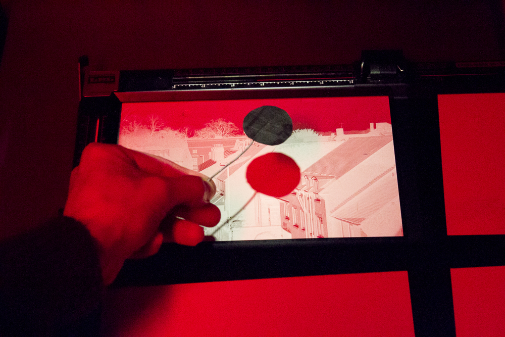 Dodging the print under the enlarger light using a simple card dodging tool