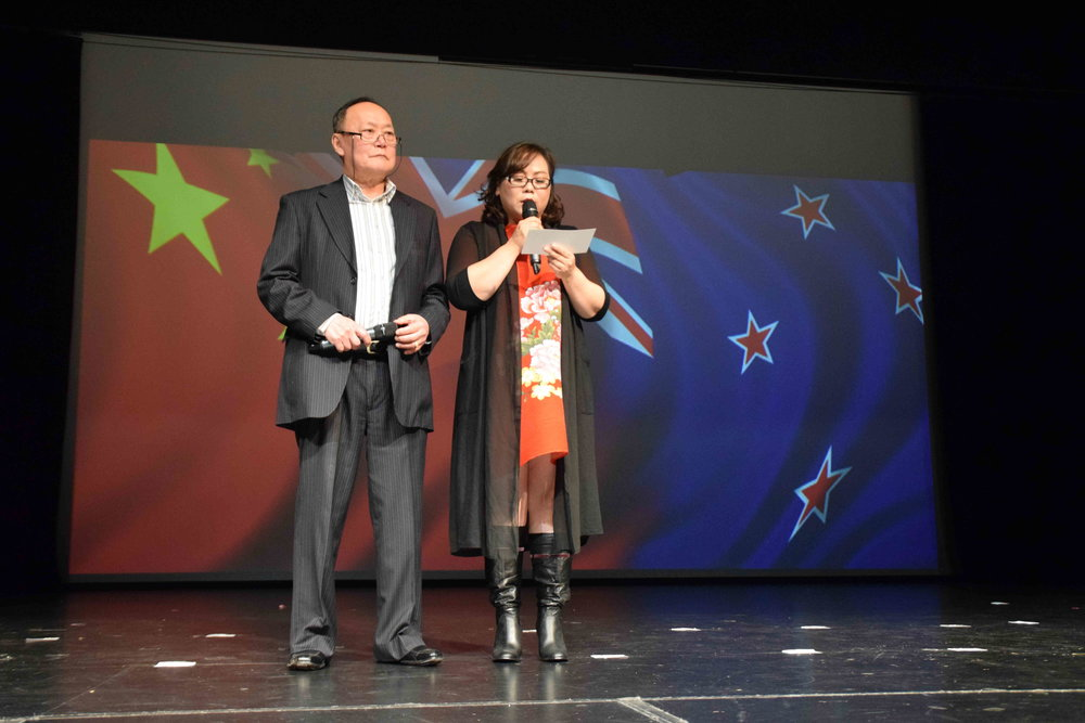 Zhonghua Society's President Wendy and Patron Winston welcoming the guests; it was also a fund-raising event for Kumara and Ross Chinese Miners Memorial Reserve being built on the West Coast