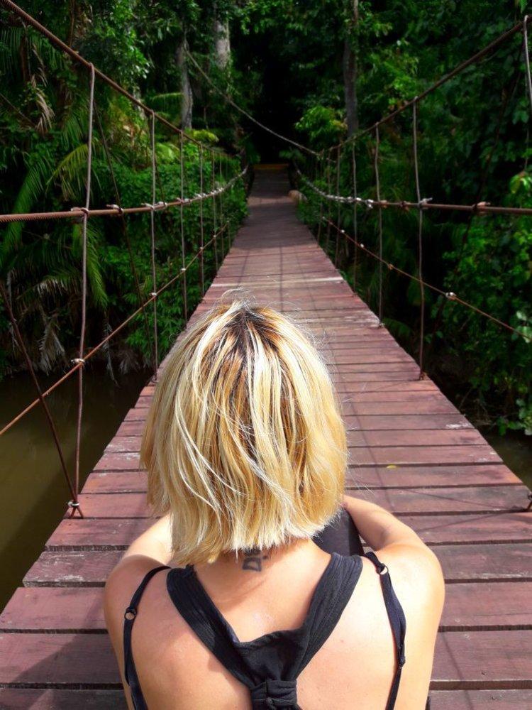 Sitting on a bridge inside Khao Yai National Park | Wanderlust Movement
