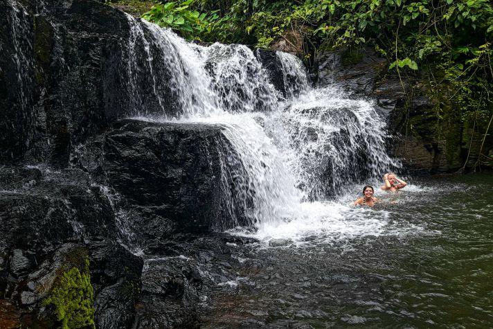 Swimming under waterfalls in Khao Yai National Park | Wanderlust Movement