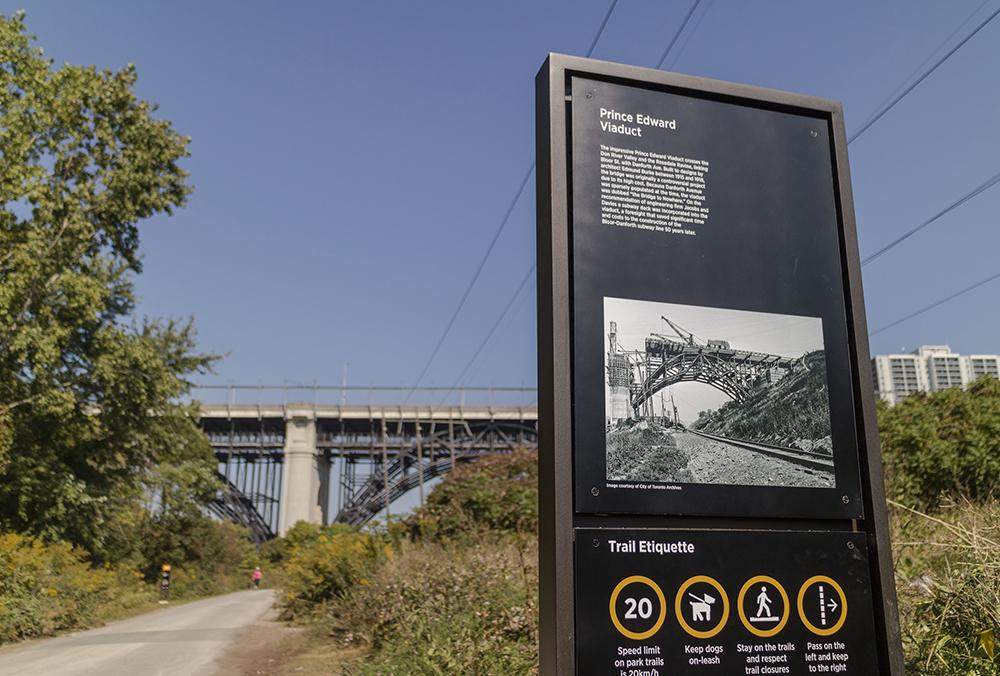 The signs include interpretative heritage information