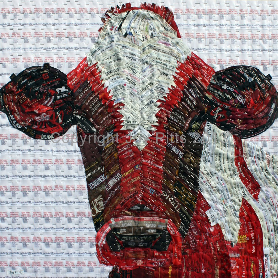 Red Cow with used clothing labels 60 x 60 cm.  (Forms part of the collection 20,000 used labels)  It took five years to gather sufficient red labels to produce this canvas.