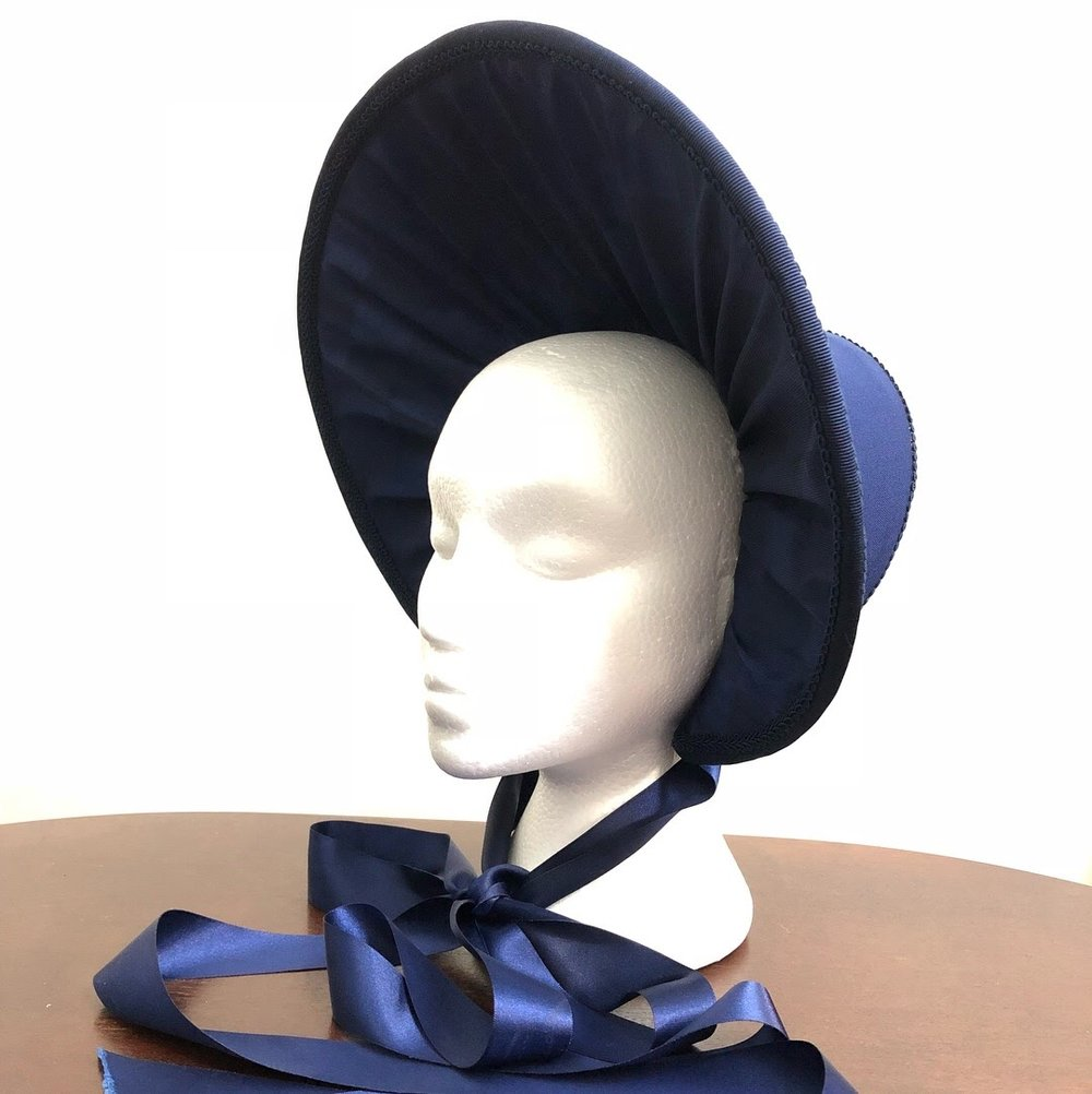 "Cosette Bonnet - Les Miserables   Profile view of 1830s bonnet made for character ""Cosette"" in Nova Music Theatre's production of Les Miserables, Oct/Nov 2017. Wired buckram base with Fosshape padding, hand stitched fabric, gimp braid trims and satin ribbon."