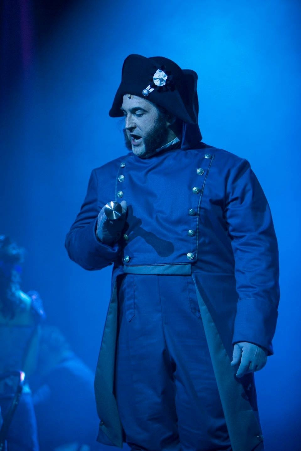"Javert Bicorn Hat - Les Miserables   On stage photo of the bicorn made for character ""Javert"" for Nova Music Theatre's production of Les Miserables, Oct/Nov 2017. Blocked 100% wool felt with wired edge bound with hand sewn grosgrain. Stiffened crown with inner hat band. Black and white cockade made by another seamstress.  Photo by Gavin D Photography"