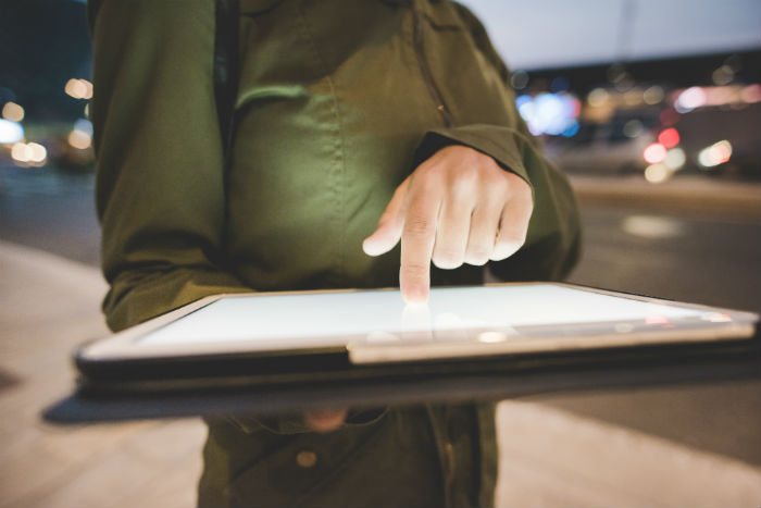 Man pointing at tablet.jpg