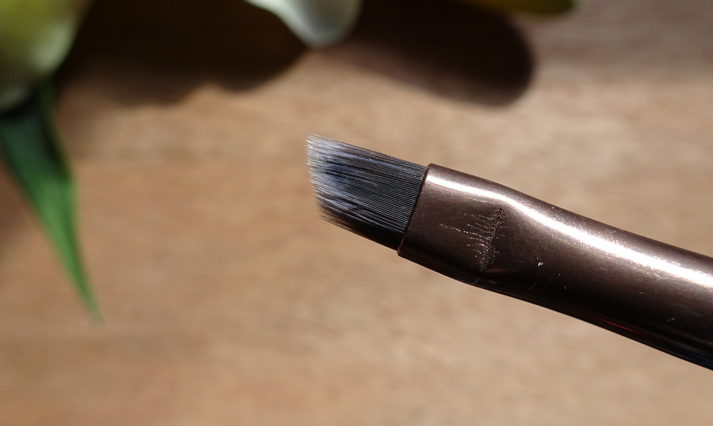 Close up of the Luxie Rose Gold Small Angle Eye Brush 215 brush head