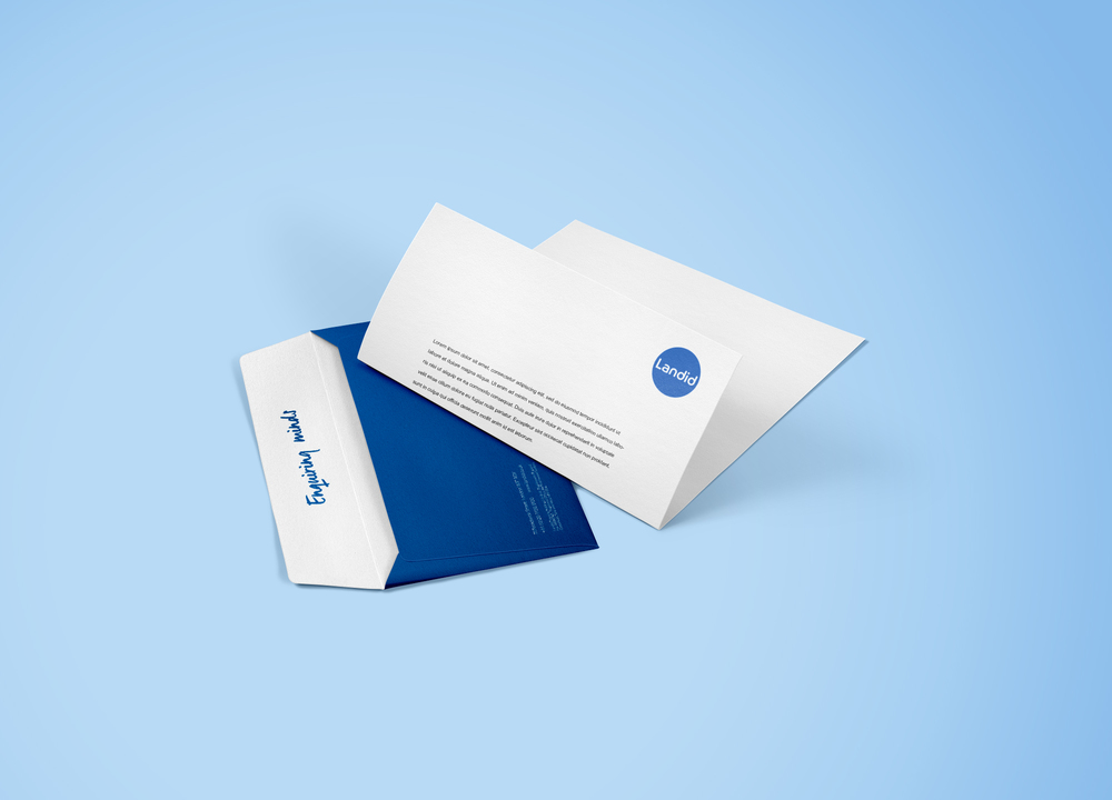 Landid branded envelope with their slogan 'enquiring minds' inside in the fold. Headed paper created by S-Kape includes a foiled blue circle log.