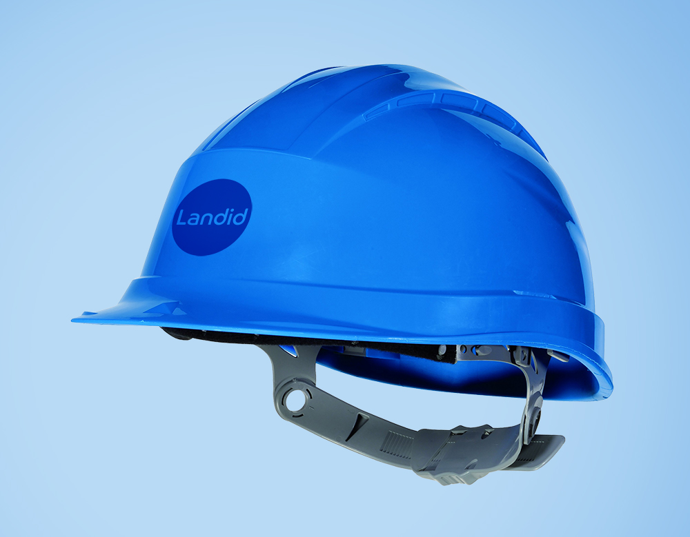 Landid branded construction helmet against a light blue background