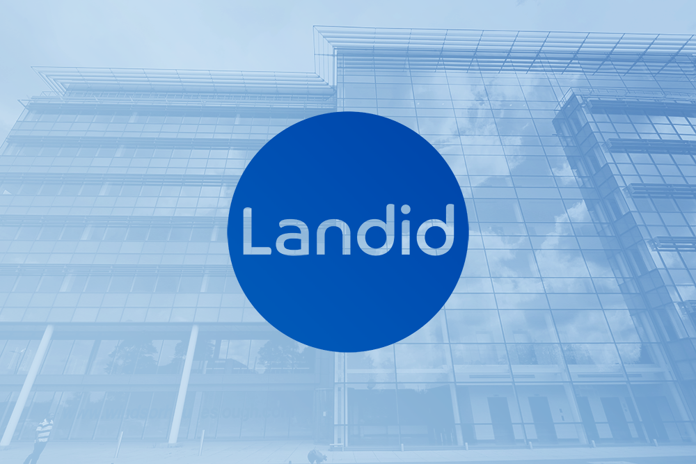 Landid corp logo against the contemporary offices in the background