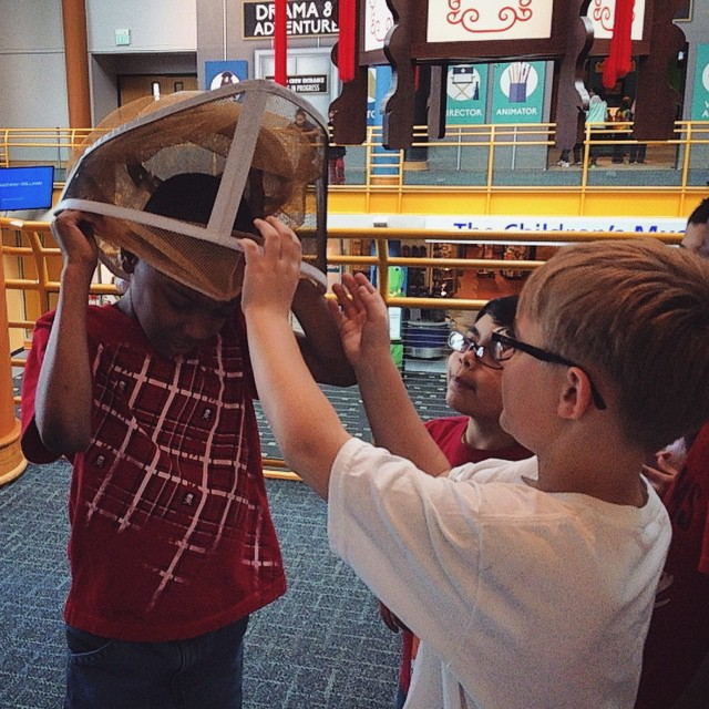 Everybody wants to try on the veil. #earthday #beepublic #beekeeping  (at The Children's Museum of Indianapolis)
