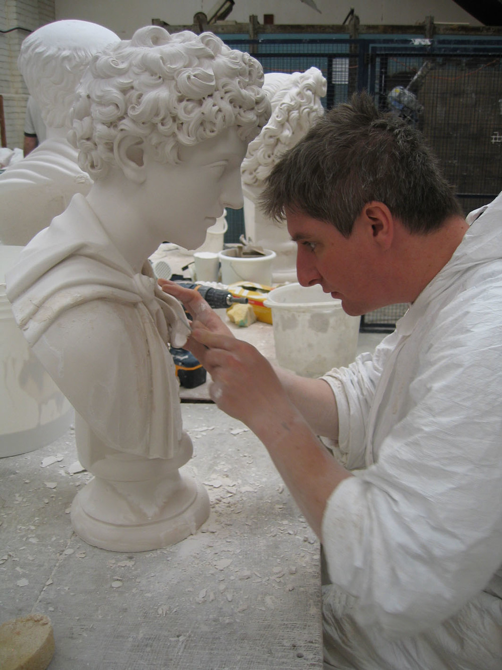 2. Holkham Sculpture Reproductions (Neil doing plasters) repairs d.jpg
