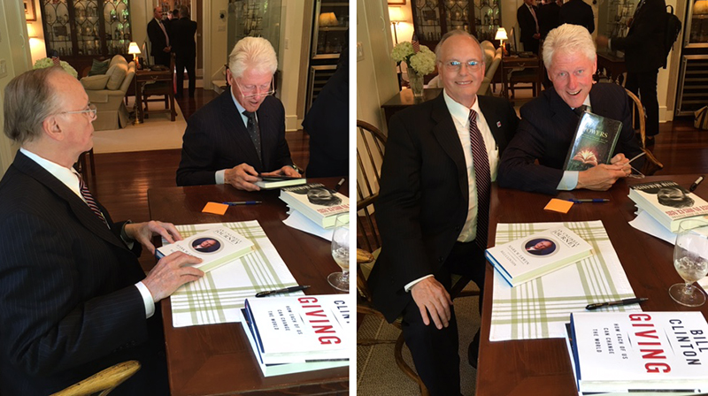 President Clinton admiring his copy of  The Powers  while visiting at Mark's home.