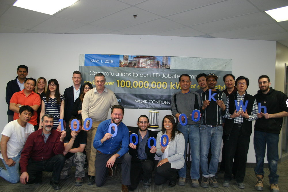 Our celebration for the 100,000,000 kWh milestone, including an LED Jobsite light shaped cake.