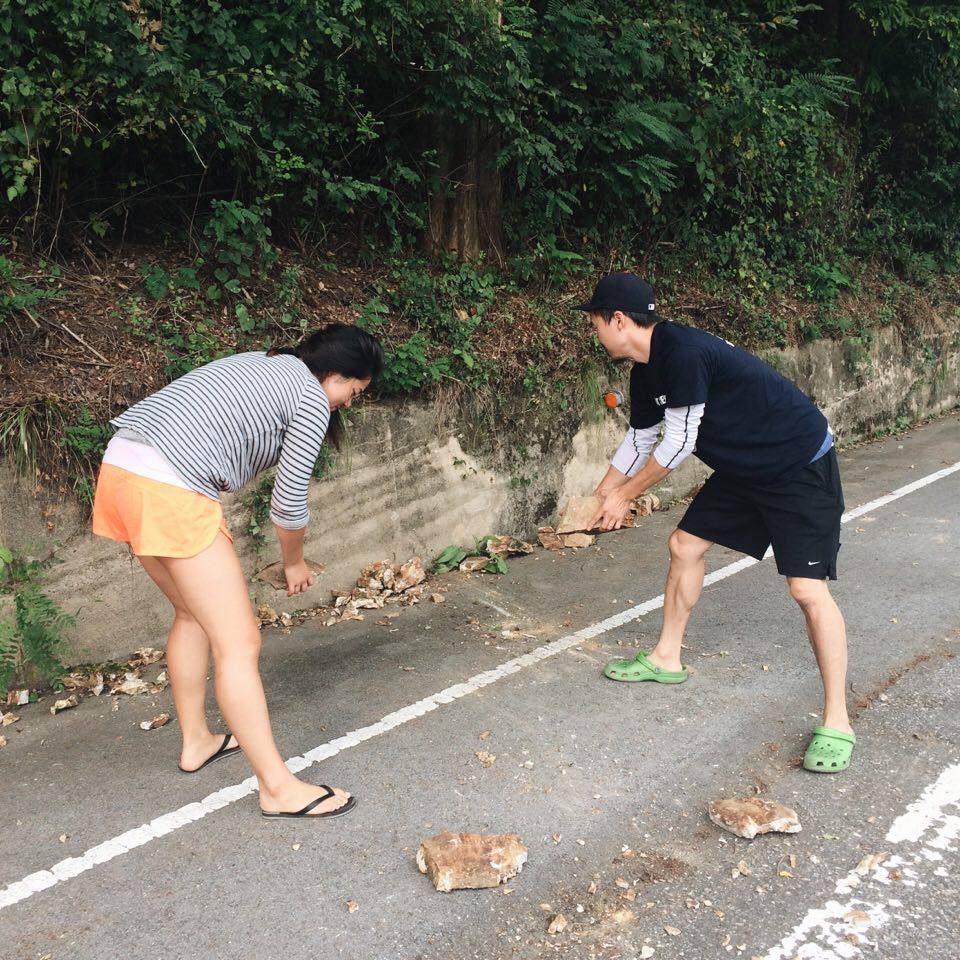 Rona and John moving rocks off to the side of the road in case of an accident!
