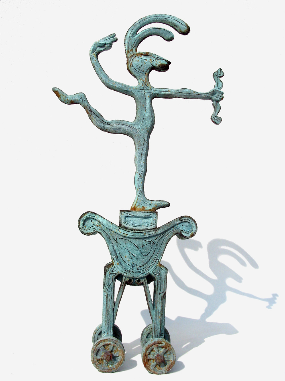 "Panjandrum l   ©   76 cm high x 39 cm wide  Unique  Two cartoon-like weather-vane hares ""Pomp"" and ""Circumstance"" take the guise of Eros the Archer on royal chariots.  This is no transportation fit for kings, but in the first image, a facsimile of a simple, yet ornate, Cretan water cart and in the second, a glorified perambulator.  Pomp and Circumstance are being pierced though the heart."