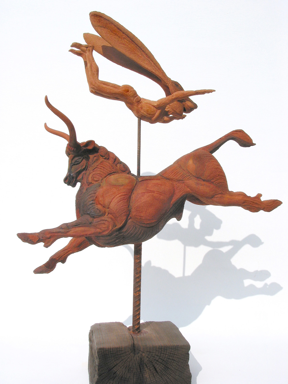 Minoan I – Haredevil   ©  93cm high x 70cm wide  Unique  This bull would make an ancient Cretan bull-acrobat feel at home, but this is a leap into fantasy: this daredevil, hare-masked figure is flying into Lewis Carroll's Wonderland.