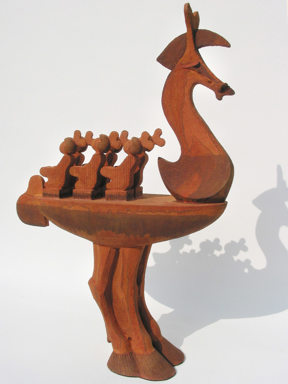 Seahorse   ©  79 cm high x 54 cm wide  Unique  A vessel with a horse-head prow and a horse-legged stand; on board, six rowers of Chinese origin.  Understated in this eclectic mix are the the horsetail rudder and the heart-shaped helmets that are disguised, wind-up toy keys.  This piece implies deception, combining the charm of a mechanical toy with the presence of an instrument of plunder. A variation on a Greek offering.