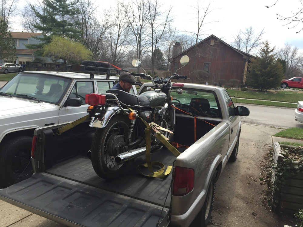 Loading it into the new owner's truck. We just strong armed it on there!