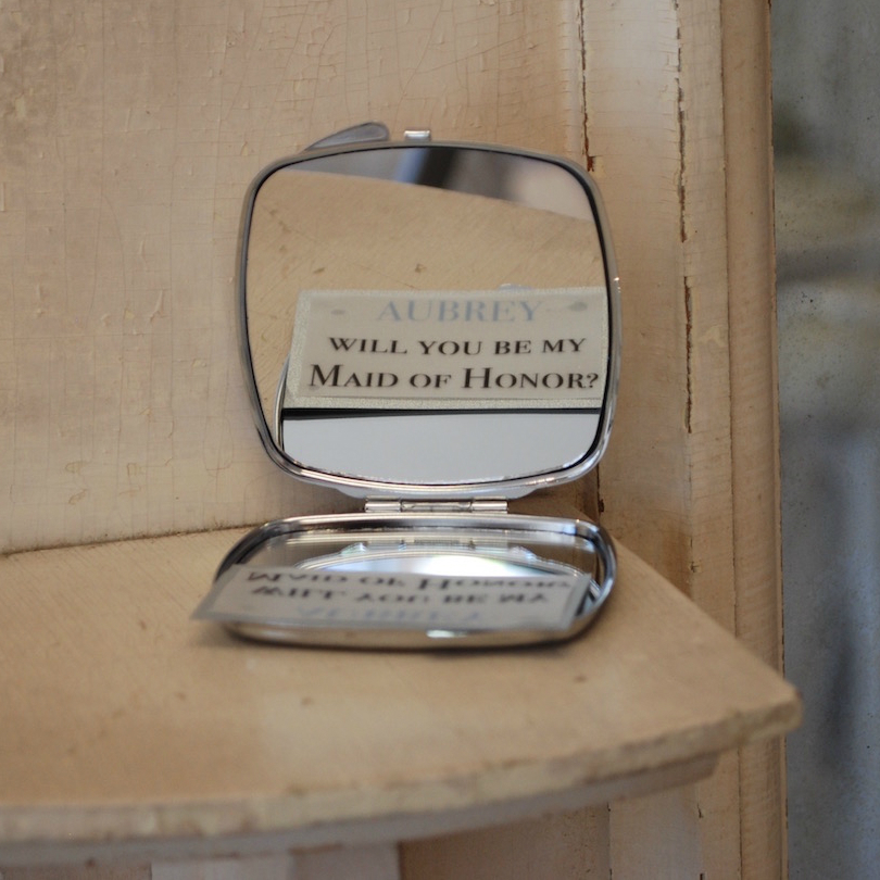 A personalized make-up mirror would be the key to asking her bridesmaids to be in her bridal party. Little vellum notes were tucked inside the mirrors in hopes they would discover her special invitation upon opening. A few friends were so happy to receive the gift that they needed prompting to open up the mirror and decipher the message.
