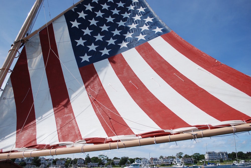 All of Edgartown found under the hand-painted sail of the catboat, Nantucket. Love this pic!