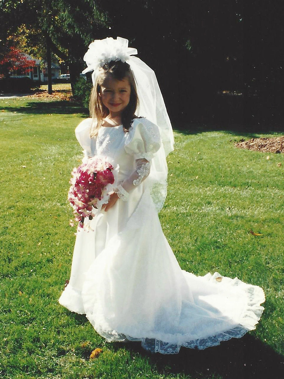 Halloween was always hand-designed in the Hunt house. Brielle, at 5 years old, in her wedding gown costume with a dreamy lace train, puffy satin sleeves, and cascading bouquet....every little girl's dream!