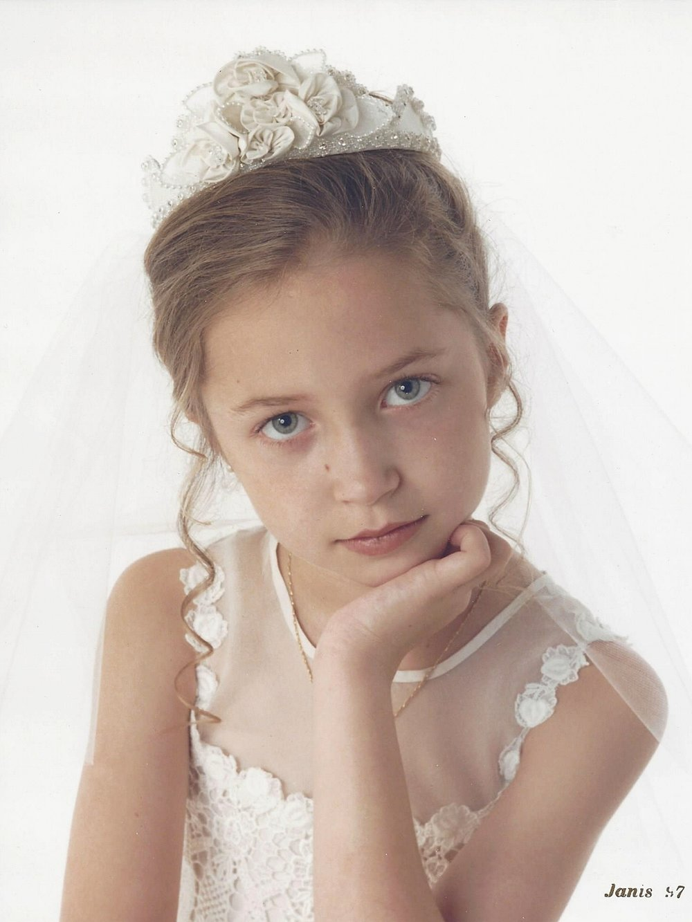 Brielle's holy communion dress and headpiece were designed from silk taffeta, silk organza, and French Guipure lace. Her 1997 dress design was a classic and could still be worn today.