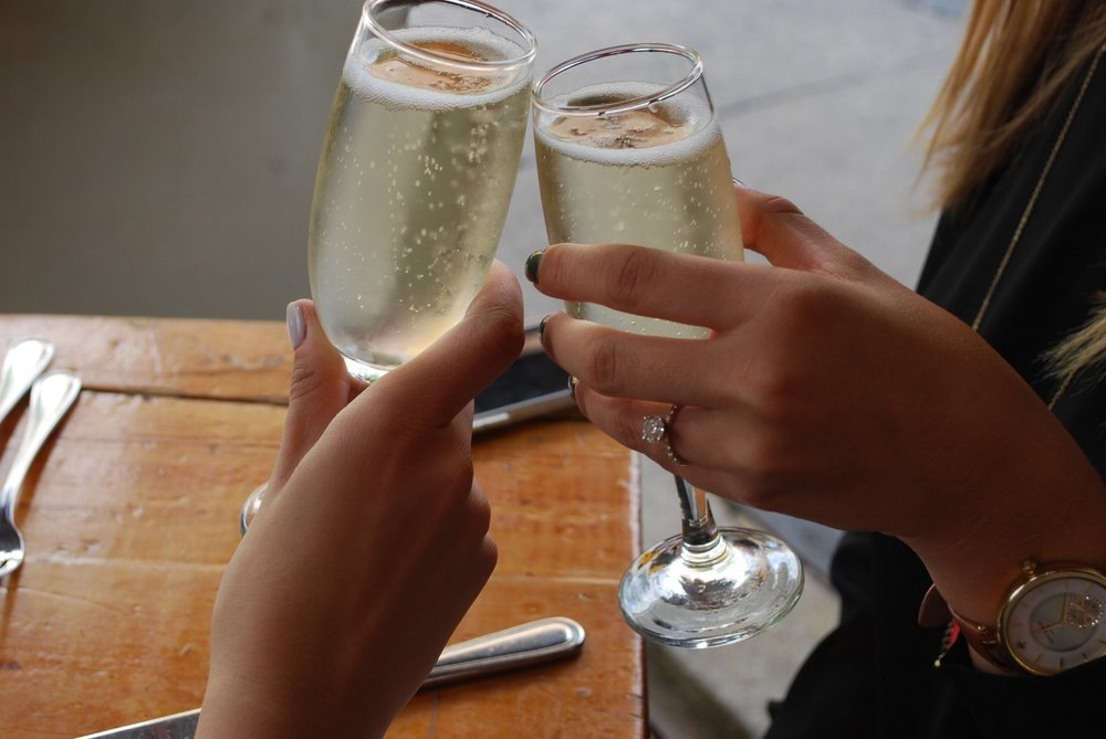 A toast between the bride-to-be and maid of honor began the day.
