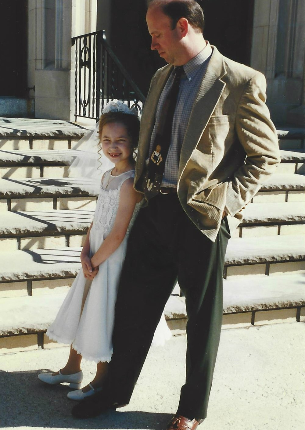 Brielle and her father, Jeff, at St. Mary's Church for her First Holy Communion in 1997.