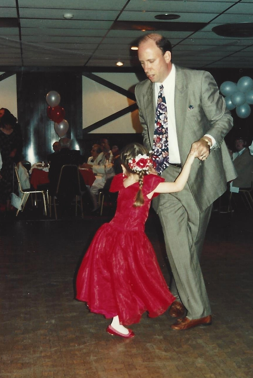Dance fever began at a young age. Brielle as a little flowergirl dancing with her dad in 1993.