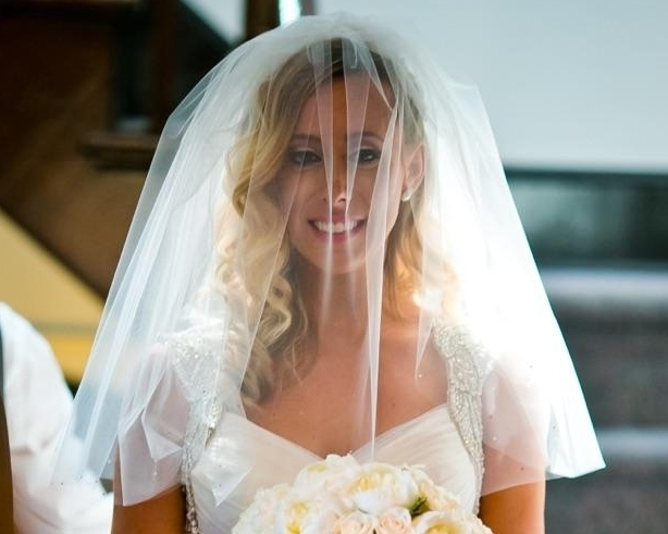 We designed a short, stylish blusher for Angela. It went perfectly with her wedding day look. Photo by MPW Media Group.