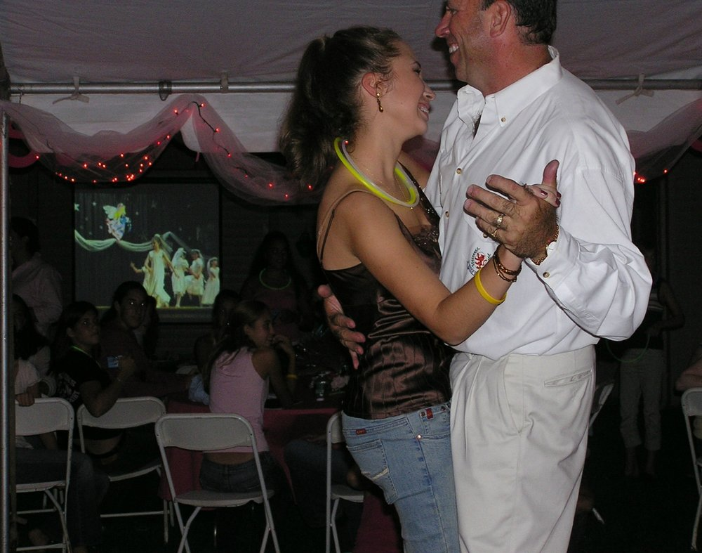 "Dancing to ""Butterfly Kisses"" at Brielle's Sweet Sixteen while a video of their dance recital debut, dancing to that same exact song, plays simultaneously in the background."