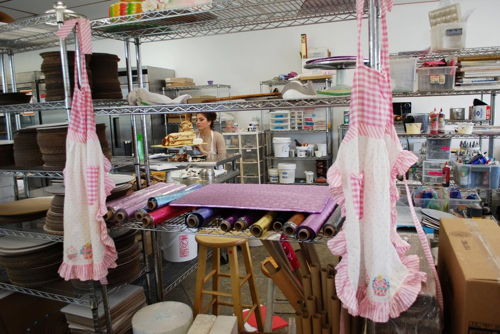 Loved this view of the master work station. The aprons reminded me of my beloved Grandma's collection.