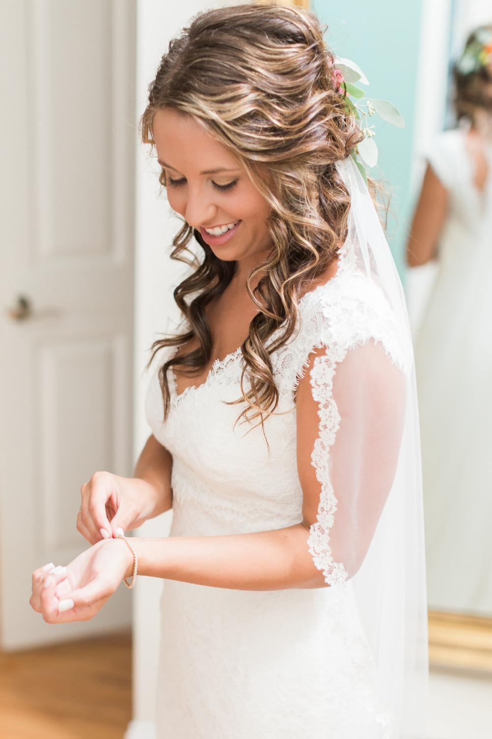 We designed a custom veil for Brittany Tilley made from European net and hand cut French lace.
