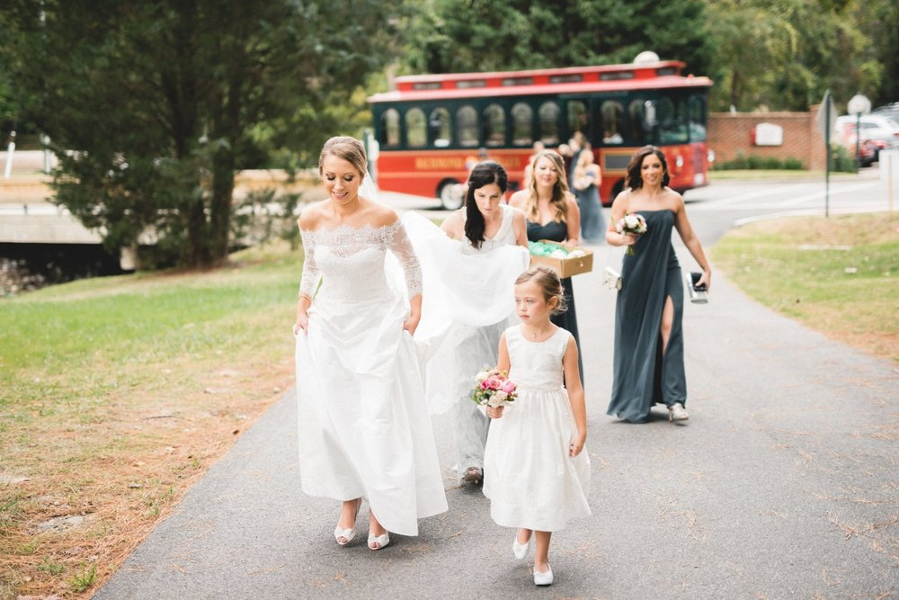 "The trolley had a bit of maneuvering problems on campus. Brielle said, ""Stop right here! We are getting out!"" She had no cares about the uphill walk, or the steps, in her heels. She was ready to get married!"