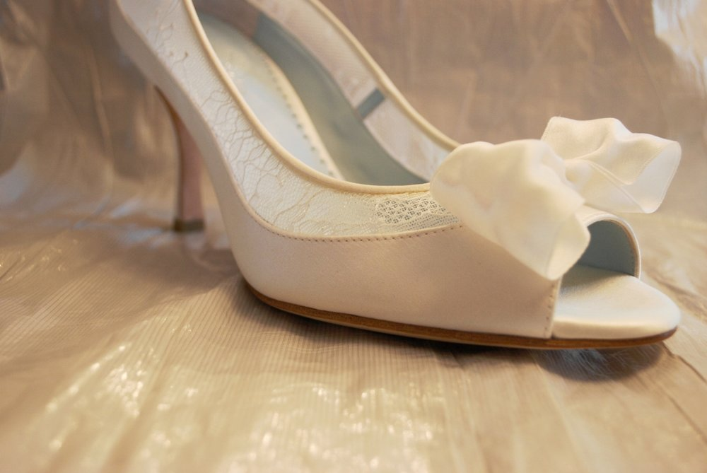 I added a softly sculptured bow made from silk to the tip of the open toe.