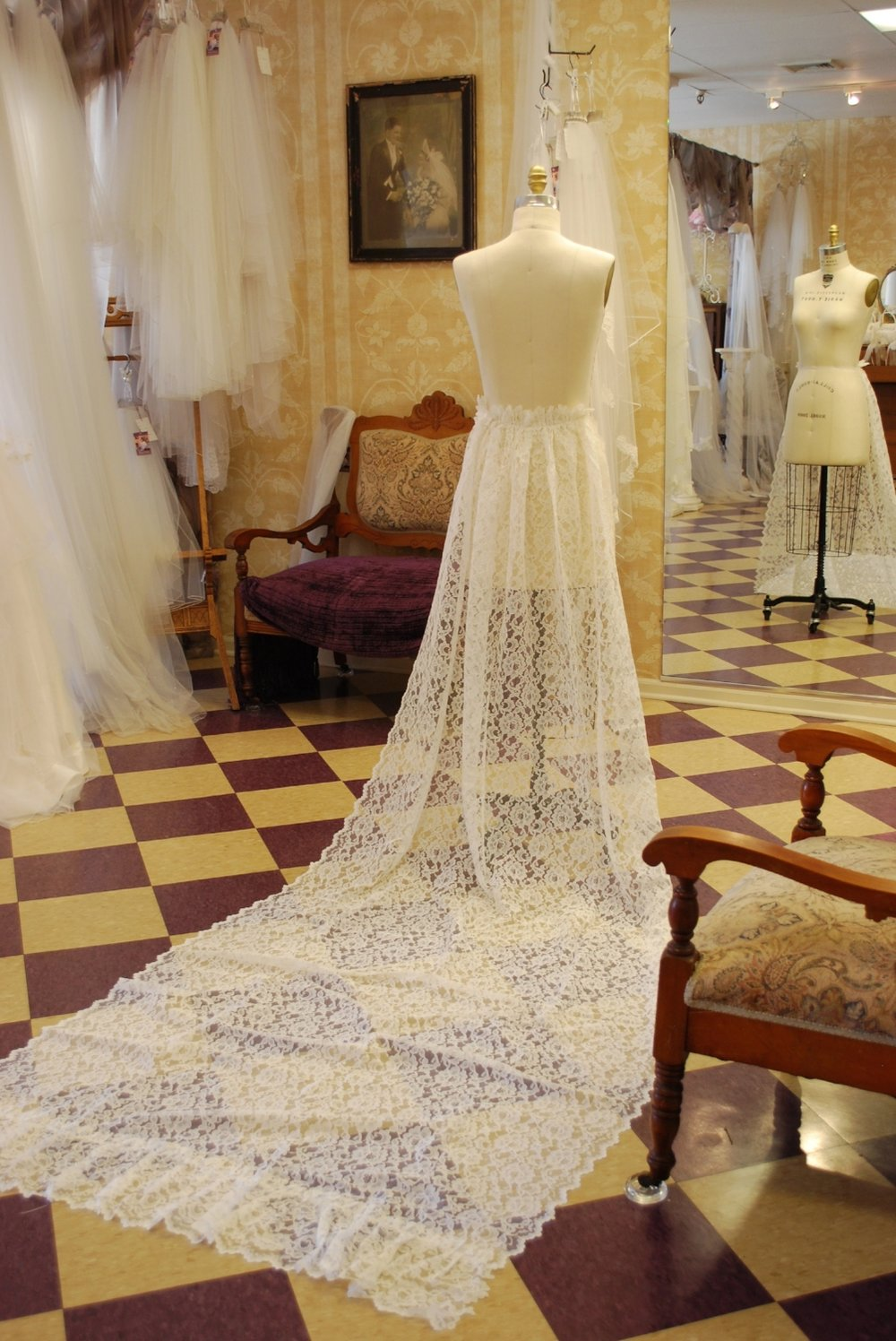 This lace train was in pristine condition. I pinned it to my dress form and admired its beauty!