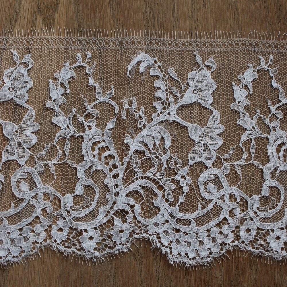 Delicate lace made on a Leavers machine which was invented by John Leavers in 1813.