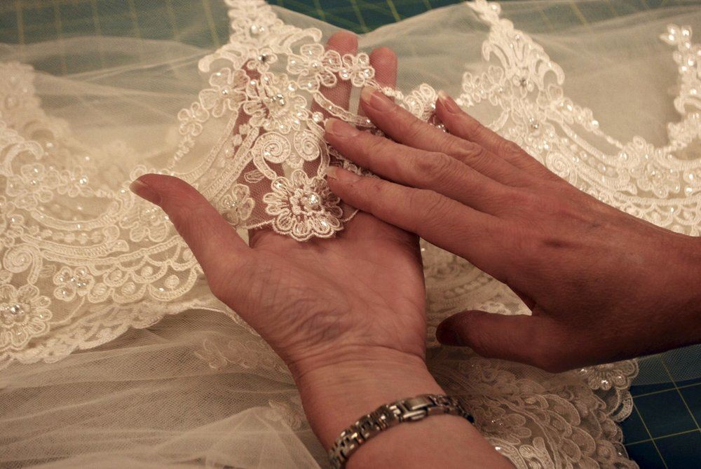 "The lace was 6"" wide and not graduated towards the top of the veil. If we could remove the lace, we could cut it down and reposition it, but the lace on Sarina's veil appeared to be glued."